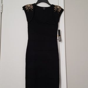 Black dress with gold shoulder embellishments